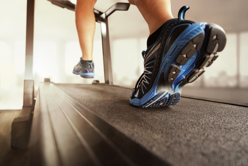 Close-up-of-feet-running-on-treadmill