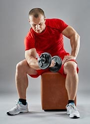 Man in red shirt lifting weight Thumbnail