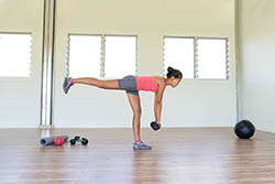 Woman exercising with leg out stretched