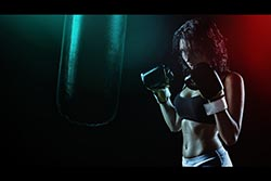 Woman with boxing gloves Thumbnail