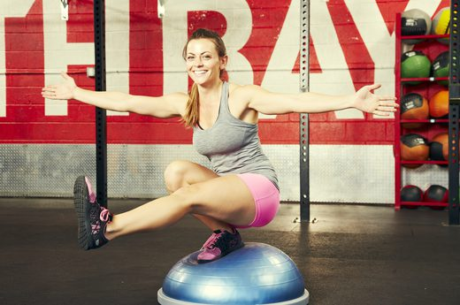 woman balancing on BOSU Ball