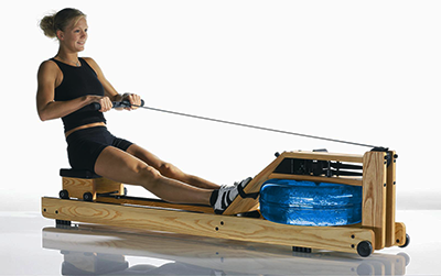 woman using water rower