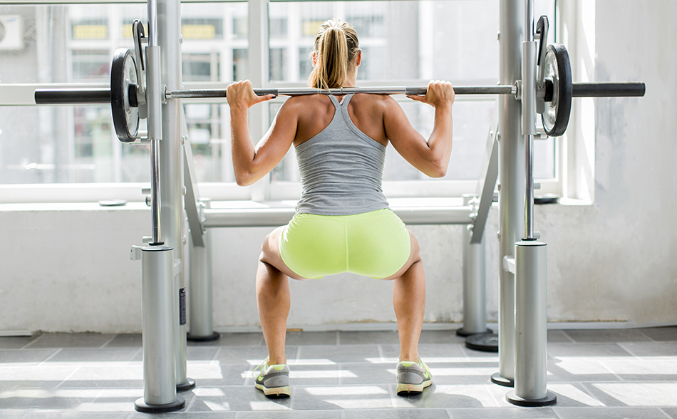 young woman training gym